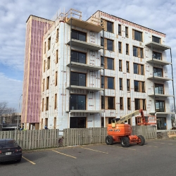 This six-story Polycrete building went up one floor per week.