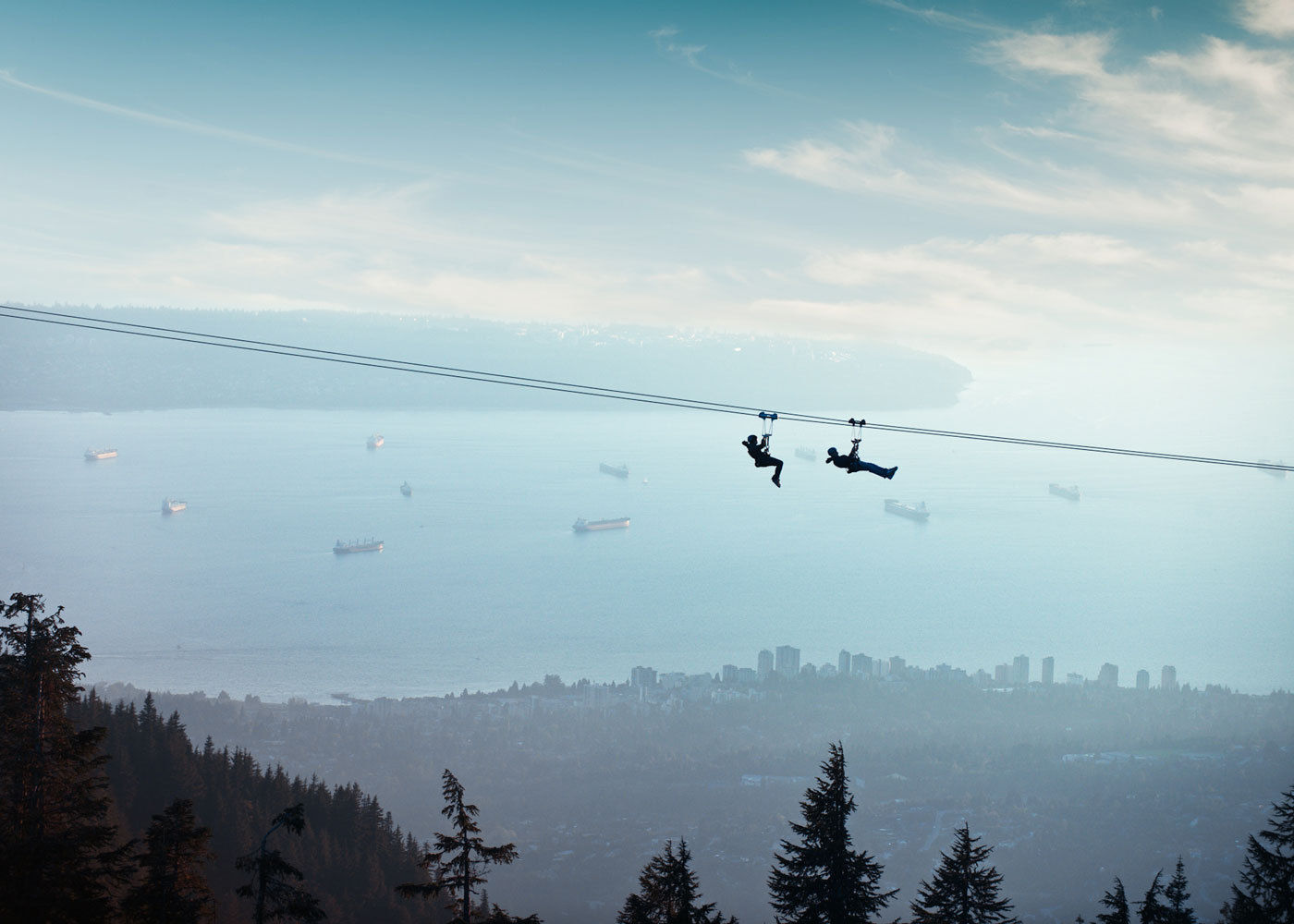 Enjoy the sights while zip-lining across grouse mountain