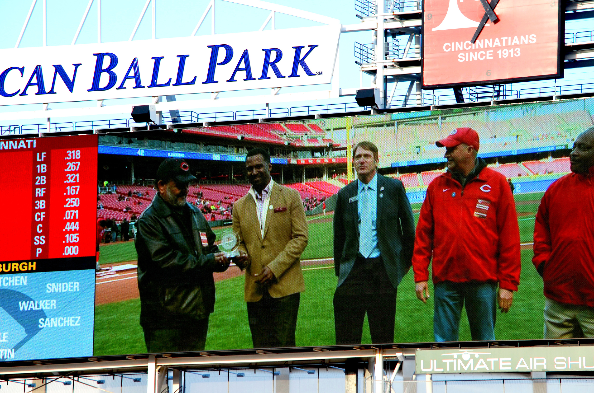 Clay Holland (Holland & Holland Inc., Sean Rutledge (African American Chamber of Commerce-Cincinnati), Charlie Frank (Cincinnati Reds), Chris Bain (Kokosing Construction Co,) and Joe Morgan (MLB Hall of Famer and former Cincinnati Reds player) at Cincinnati Reds Great American Ballpark. April 15, 2014