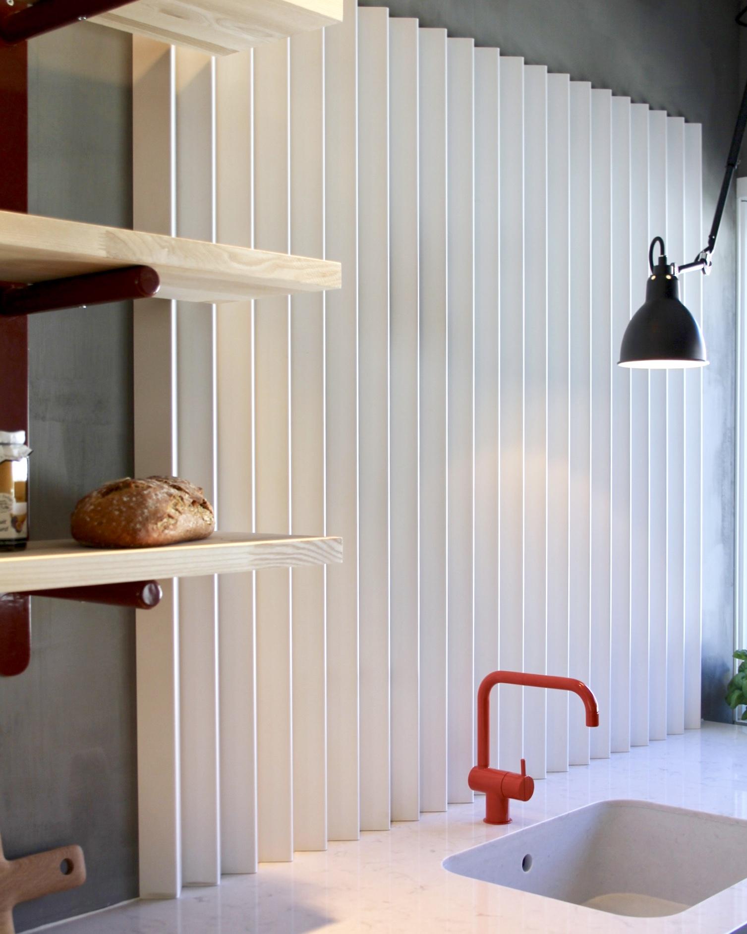 Bespoke shelves with a custom made folded metal splashback.