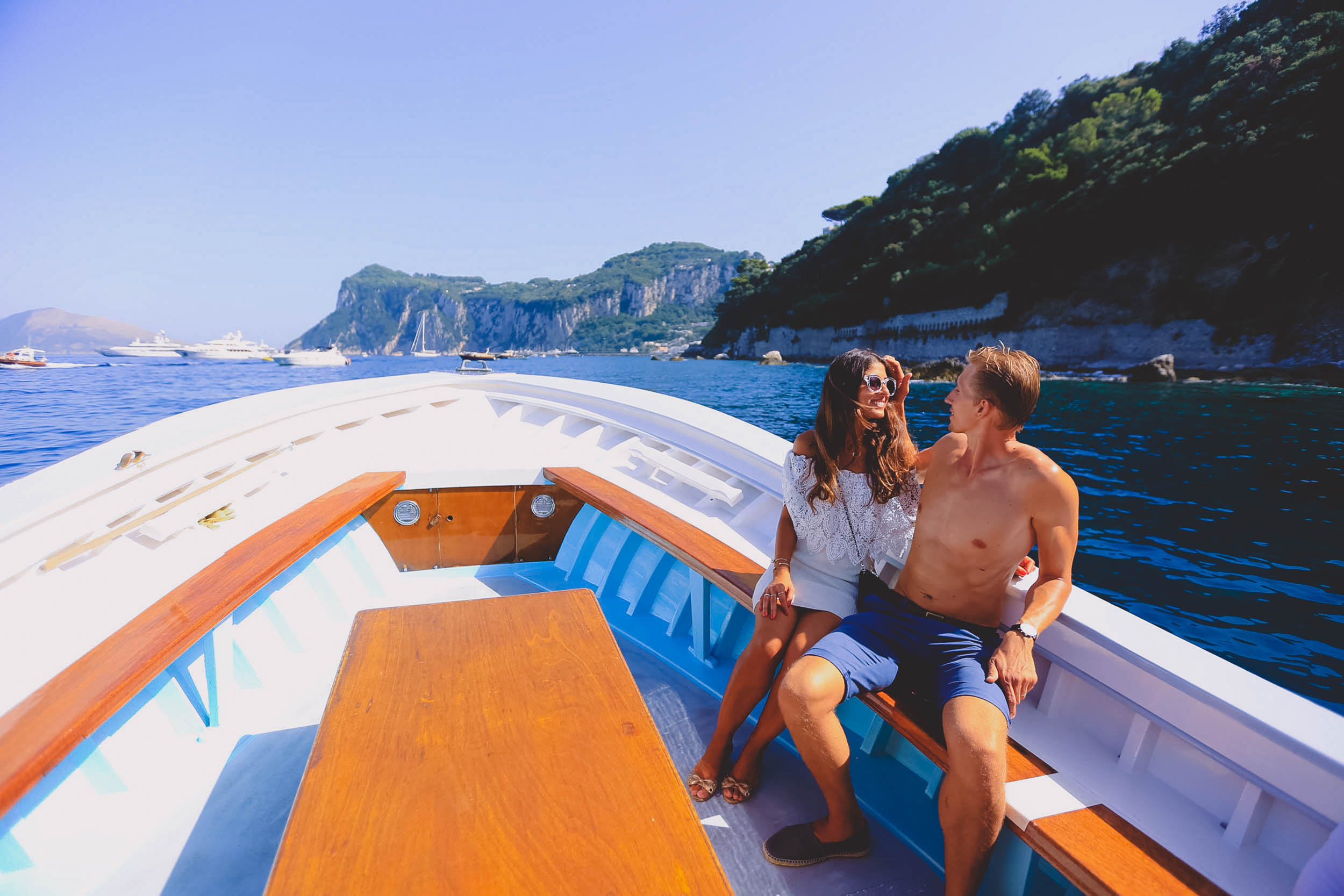 Exploring the Capri coastline by boat is a must-do activity
