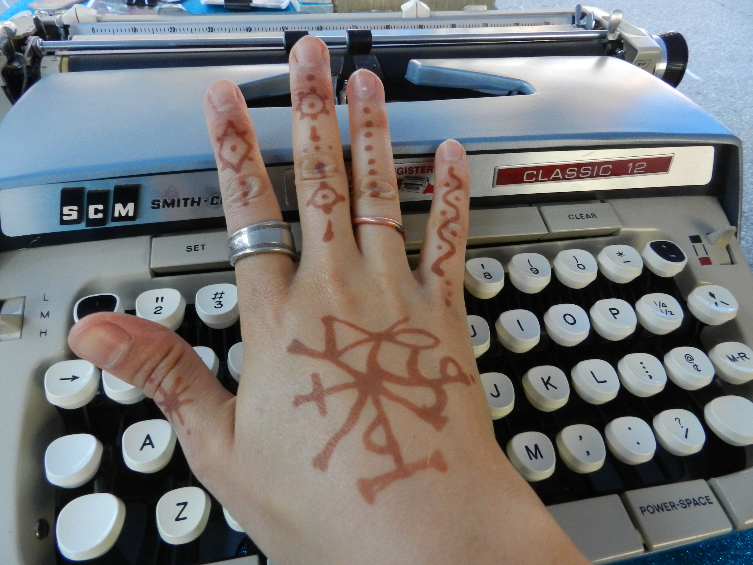 """Renee also designed the symbol on my hand. It means """"everything is connected."""""""