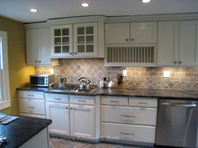 White kitchen design with a tile backsplash.