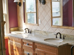 Bathroom design with large countertop and double sink vanity.