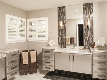 Contemporary bathroom design with wall-mounted vanity and mosaic accent tiles.