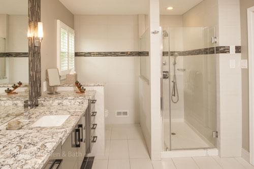 Bathroom design in Newtown, PA featuring white bathroom fixtures.