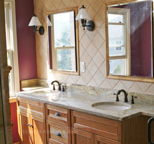 Bathroom design featuring wood vanity and neutral wall tiles with a contrasting wall color.