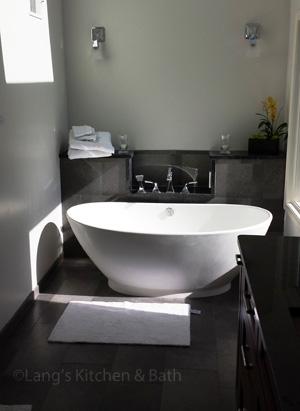 Transitional bathroom design with freestanding bathtub.