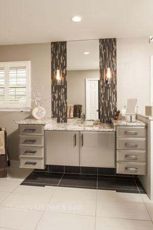 Contemporary bathroom design with dark accent tiles.