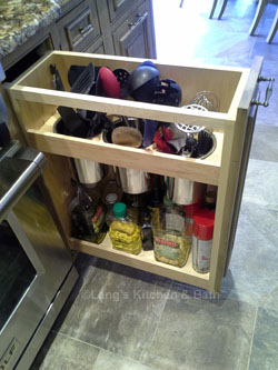 Pull-out storage for cooking utensiles and supplies.