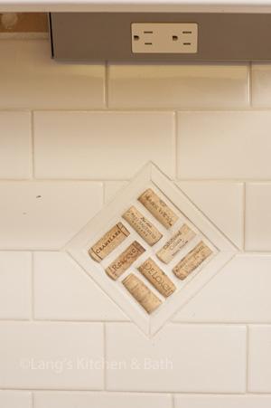 Kitchen design featuring angled power strips under kitchen cabinets.