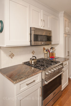traditional kitchen design in Yardley, PA with custom designed backsplash and Viking range
