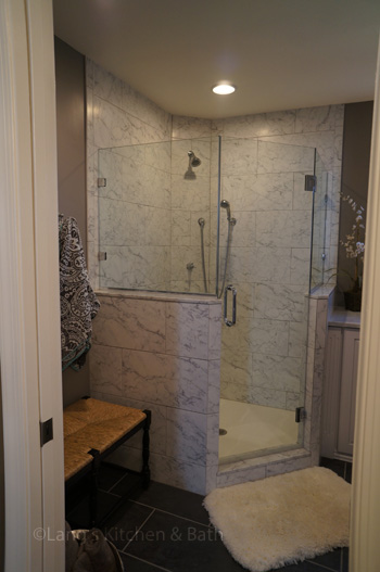 Bathroom design in Yardley, PA with Carrerra marble tiled, angled shower