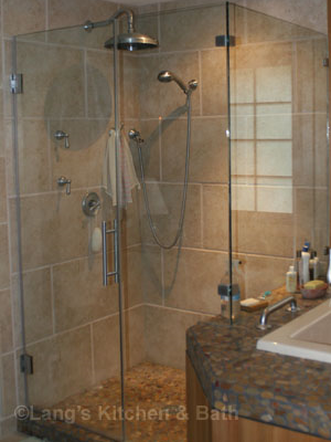Asian influence bathroom design with riverrocks and warm cedar wood