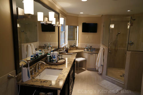 Master bathroom design with a double sink vanity and a built-in make up table.