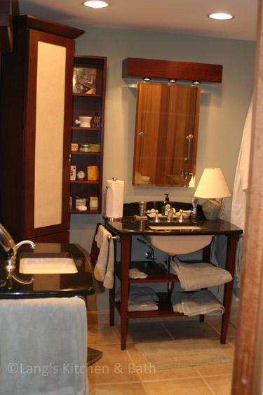 Bathroom design with two vanities with open shelf storage.