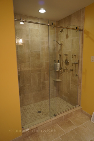 Bathroom design with extra large shower with a Dreamline shower door.