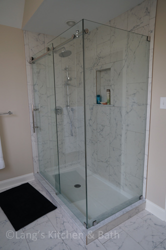 Master bathroom design with a frameless glass shower with a double Dreamline door.