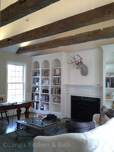 Home office upgrade including freestanding desk and barn beams.