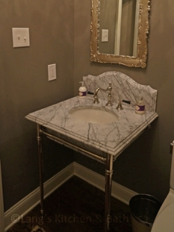 Powder ROom Featuring Marble countertop with built up edge.