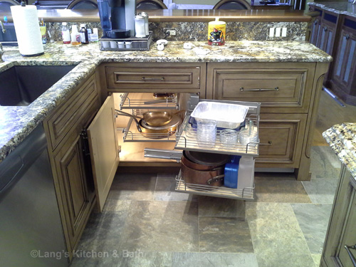 Kitchen design with magic corner pull out rack.