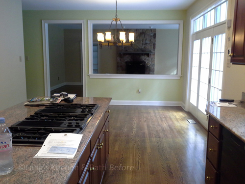 Before picture showing kitchen prior to renovation with a wall that was removed.