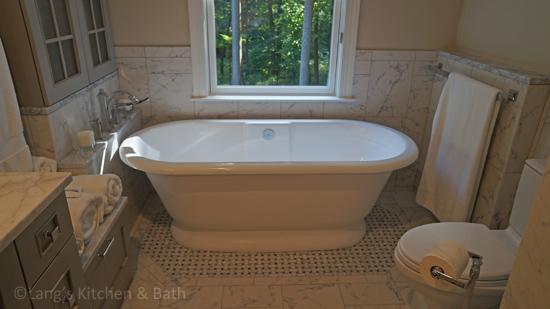 Master bath design with freestanding tub.