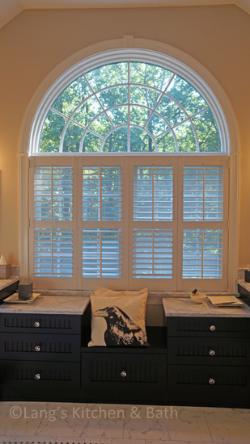 master bath design with black vanity and window seat