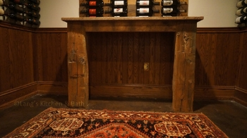 Reclaimed barn beams used to create a table in the wine refrigerator.