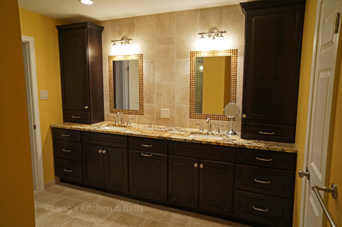 Bathroom design with a dark finish vanity cabinet.