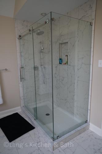 Bathroom renovation with a frameless glass shower.