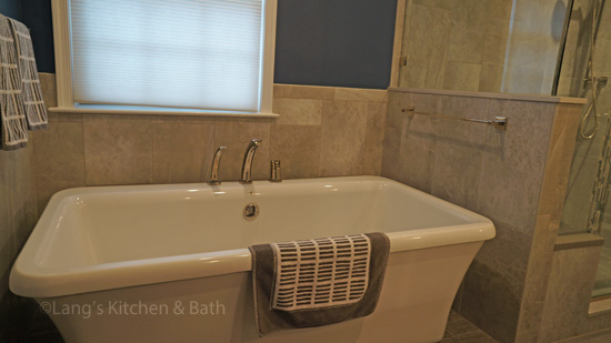 Bathroom design featuring a freestanding tub.