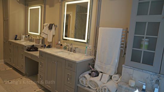 Bathroom design with large vanity cabinet.
