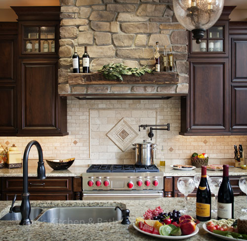 Traditional kitchen design with stone hood