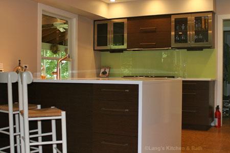 contemporary kitchen design with green glass backsplash