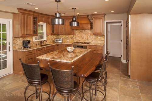 Kitchen design with wood tabletop in island.