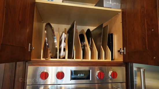 Kitchen design with vertical storage for trays