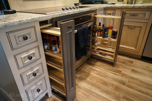 Farmhouse kitchen design with narrow pull out storage