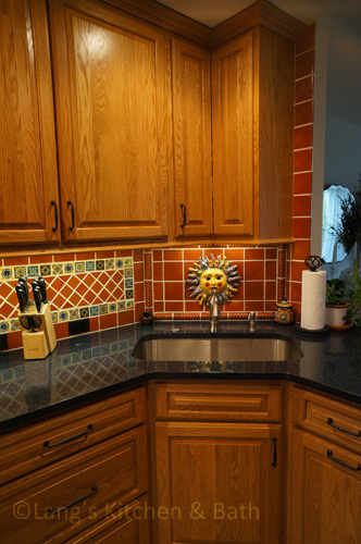 Kitchen design with angled corner sink and cabinets