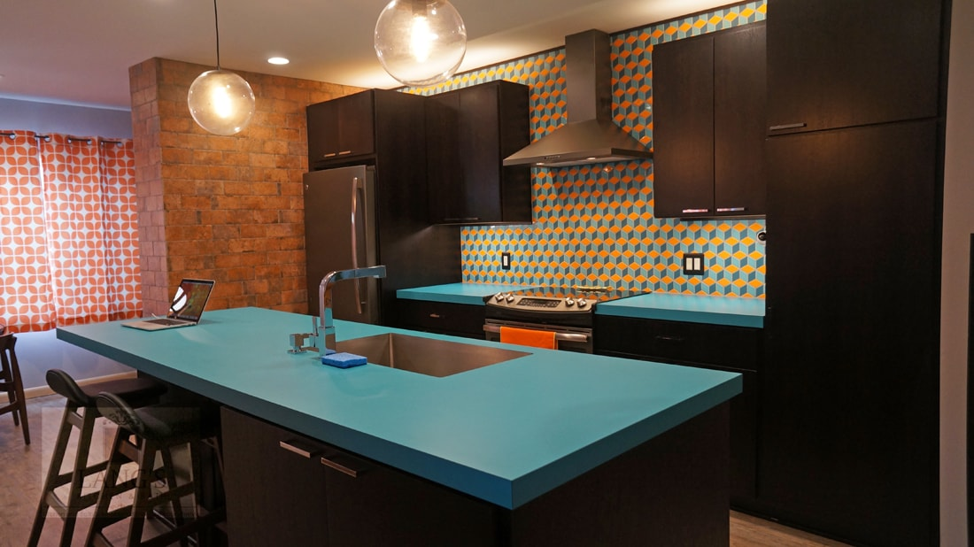 Kitchen design with blue countertop