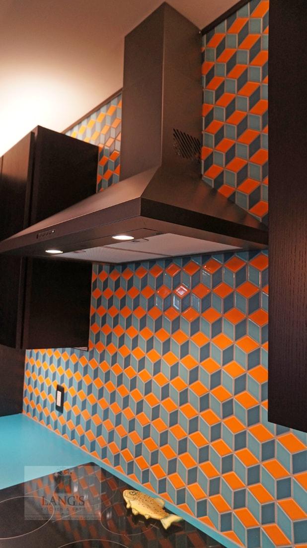Kitchen design with geometric backsplash