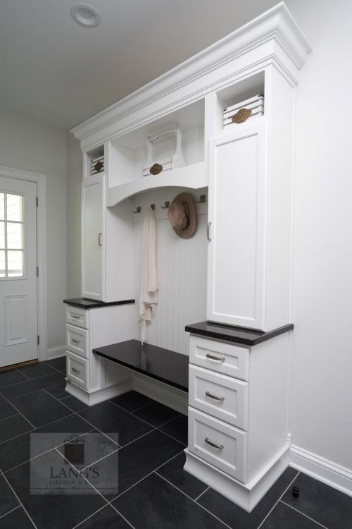 Mudroom design adjacent to kitchen design