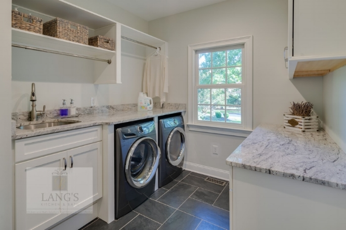 laundry room design with hanging storage