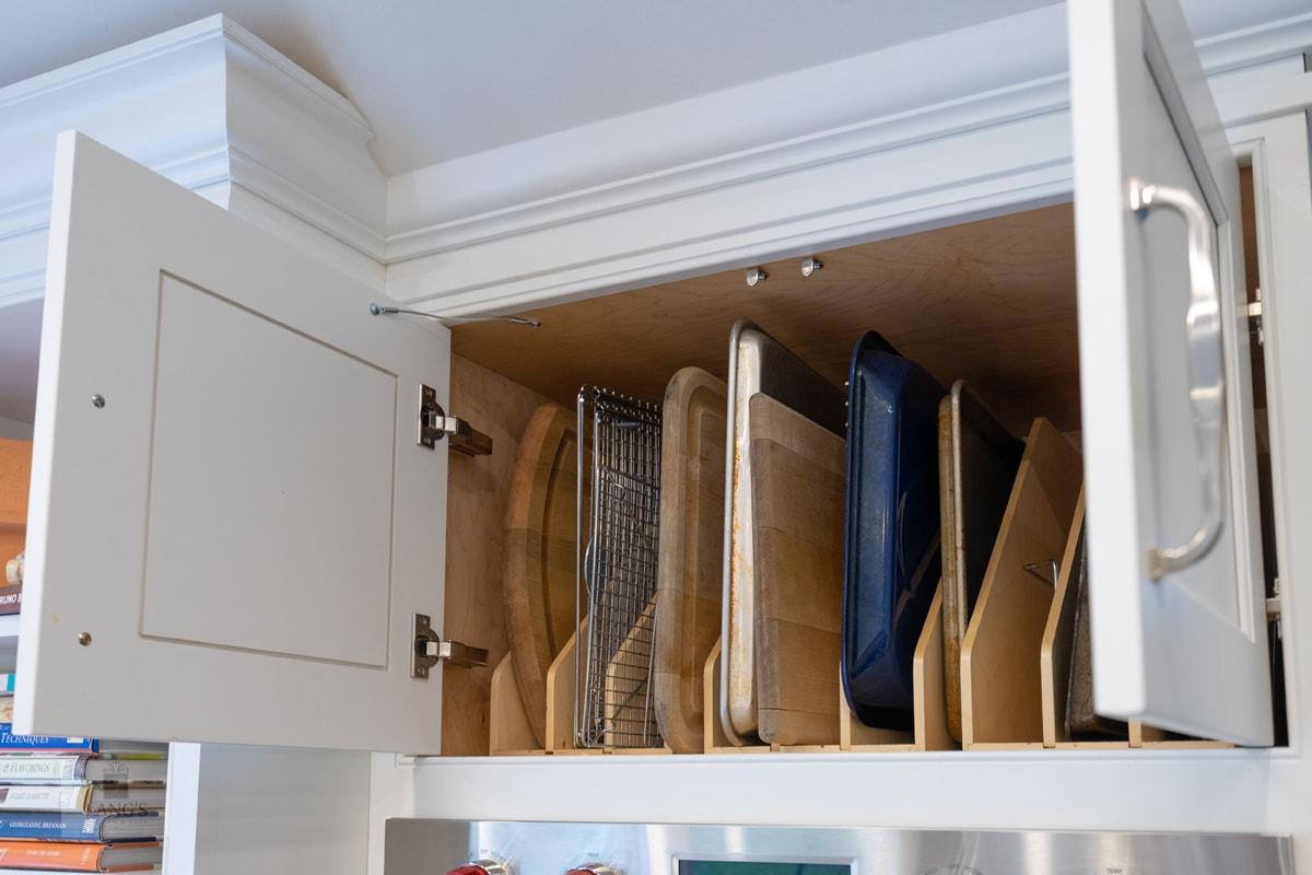 kitchen design with vertical cutting board storage