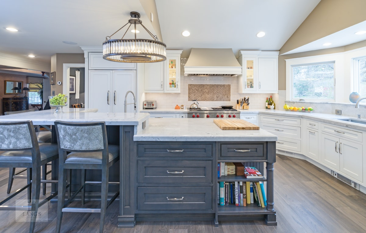Transitional kitchen design with two-tiered island