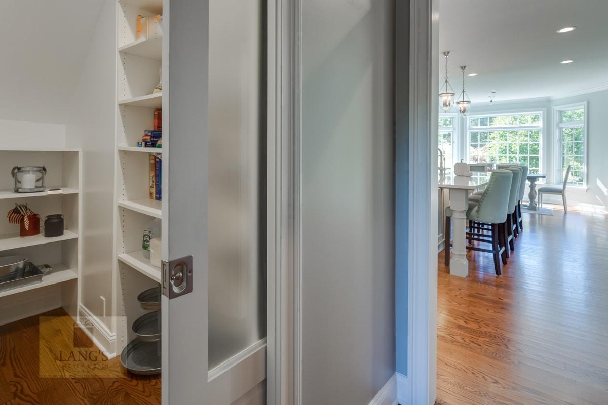 Kitchen design with adjacent pantry