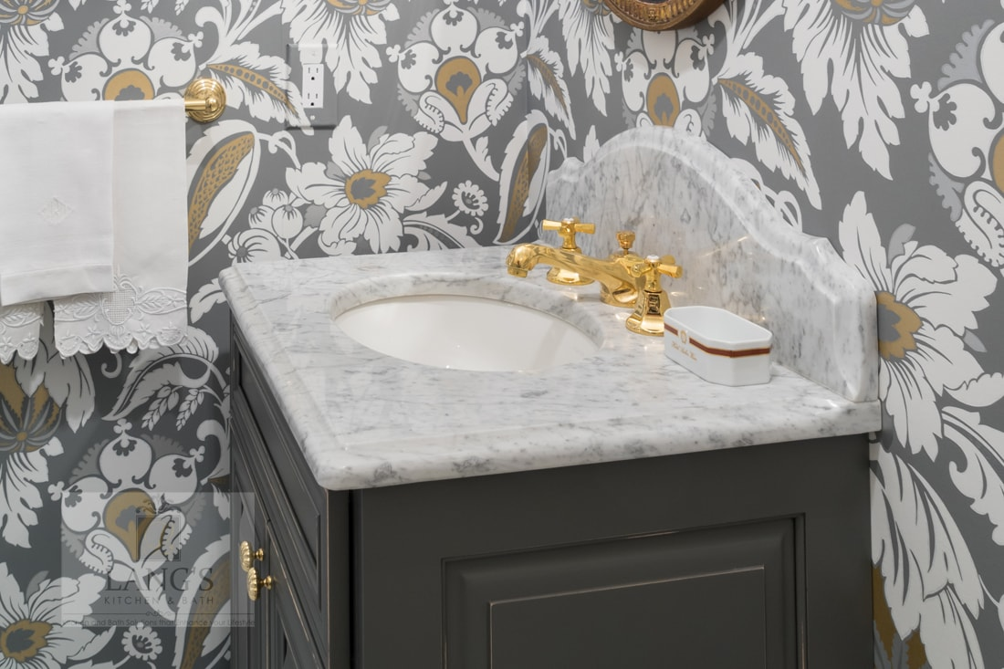 Powder room with small vanity cabinet