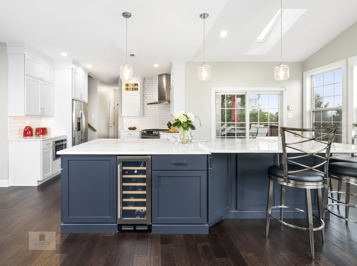 Blue kitchen island with seating area