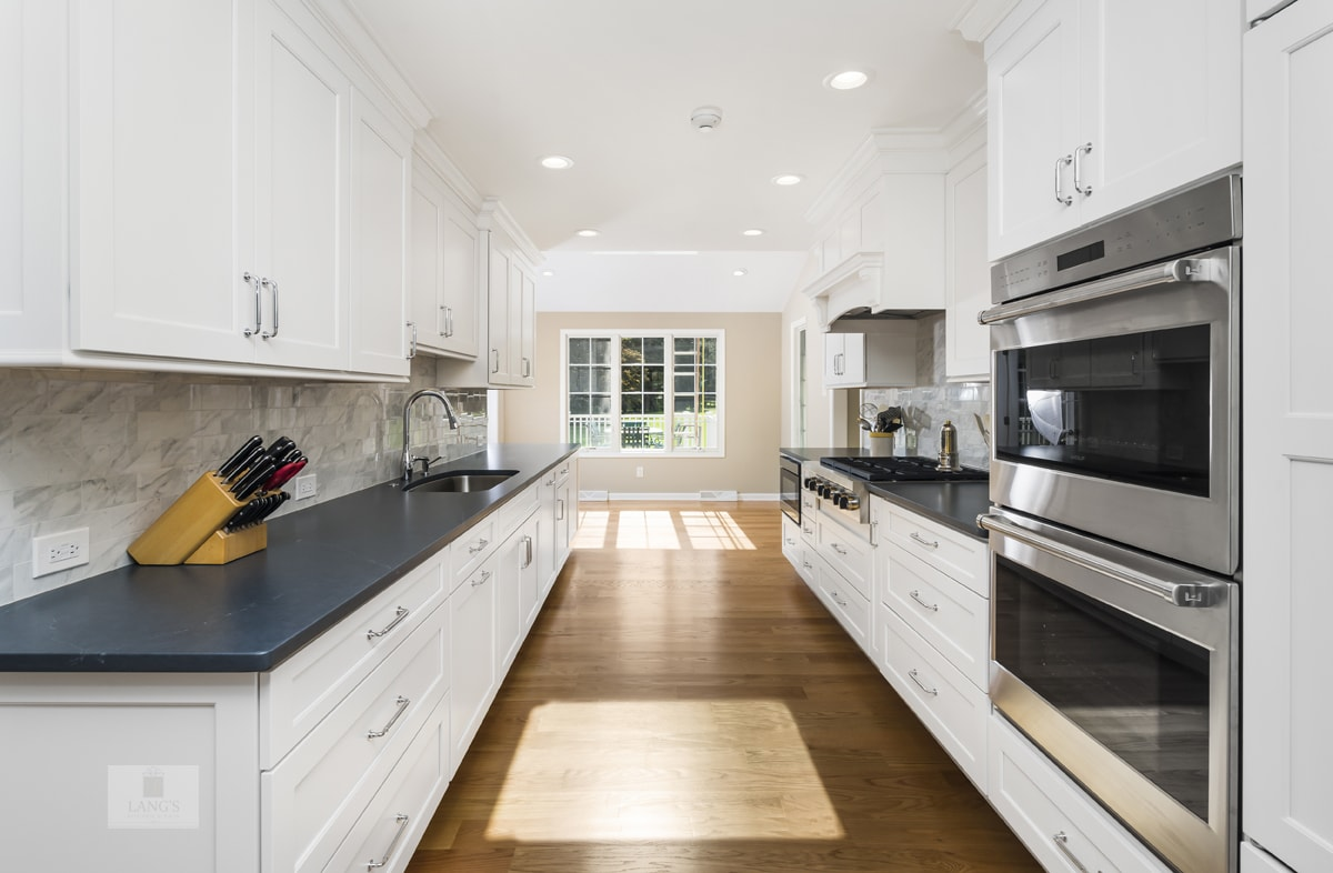 white kitchen cabinets with dark gray countertop