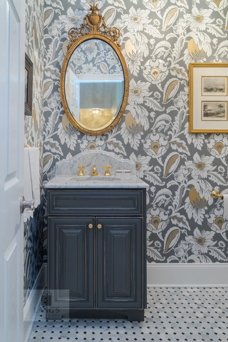 powder room with distressed cabinetry and colorful wallpaper